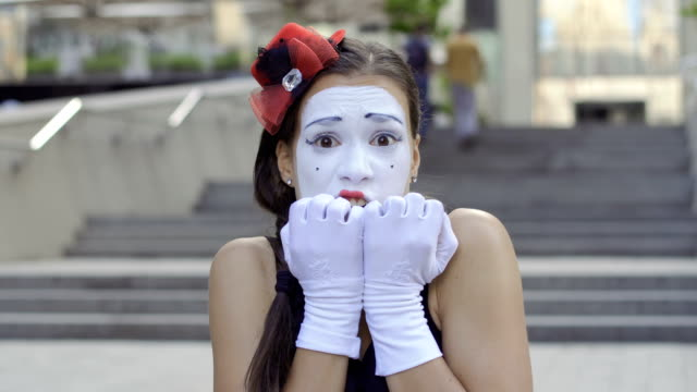 funny girl mime scary and fear something - гримировальные краски стоковые видео и кадры b-roll