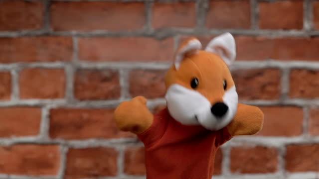 Funny glove fox over brick background