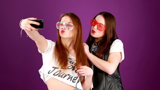 Funny hipster females making self portrait
