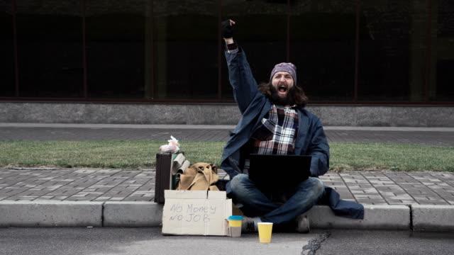 Funny homeless beggar winning a fortune online video