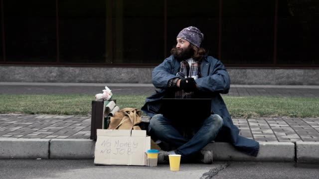 Funny homeless beggar winning a fortune online