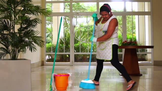 Funny Housekeeper Dancing and Having Fun With Broom video