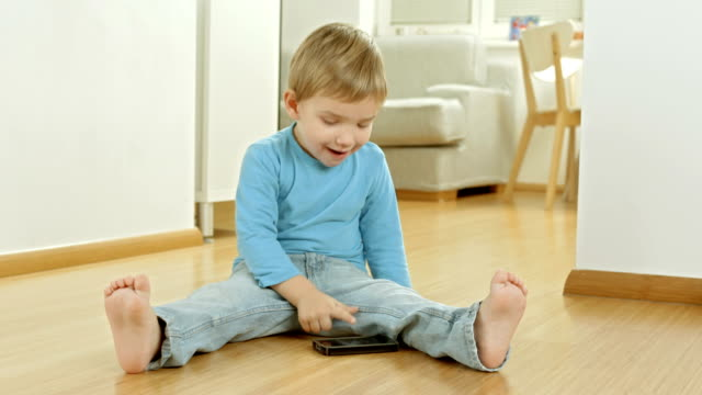 Funny Little Boy Playing With A Cell video