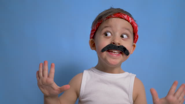 funny mexican boy with a big black mustache and a white t shirt - maglietta bianca video stock e b–roll
