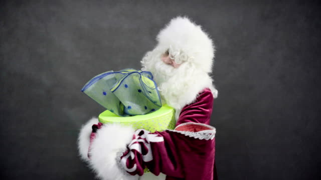 funny santa claus dancing with gift video