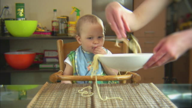 Funny scene with spaghetti & baby. Input output. HD video