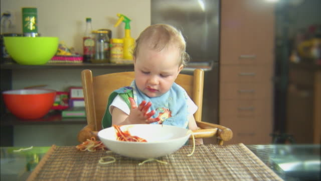 Funny scene with spaghetti & baby. Lots of emotions. HD video