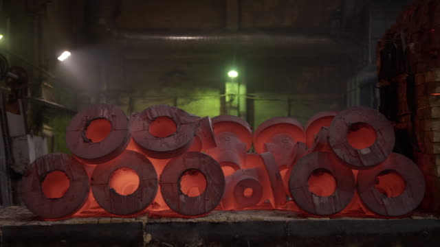 Furnace with red hot metal workpieces in foundry. Room for manufacture of metal products by casting. Casting shop for gassified models. Blast Furnace Steel Production Steel Works. - vídeo