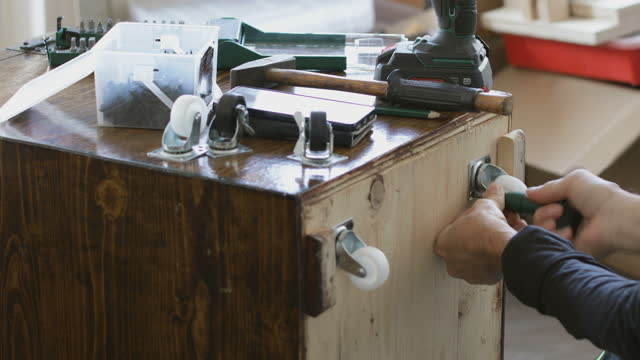 Furniture making, assembling wheels onto wooden crate video