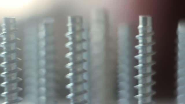 Furniture screws Confirmat ties Einteilferbinder furniture. Hazy background.