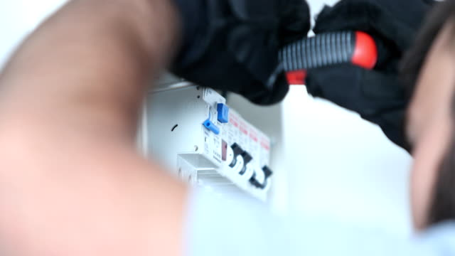 Fuse box A mans hands repairing an electrical fuse. futebol stock videos & royalty-free footage