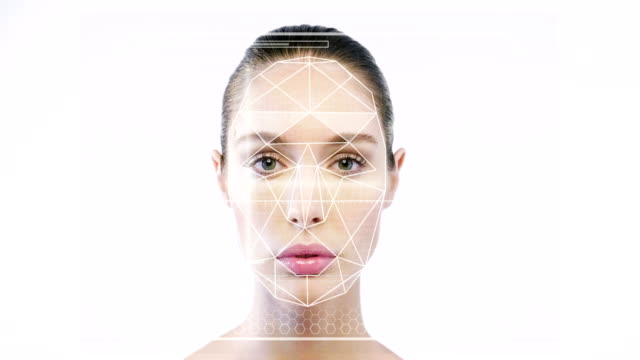 futuristic and technological scanning of the face of a beautiful woman for facial recognition and scanned person. it can serve to ensure personal safety. - идентификация личности стоковые видео и кадры b-roll
