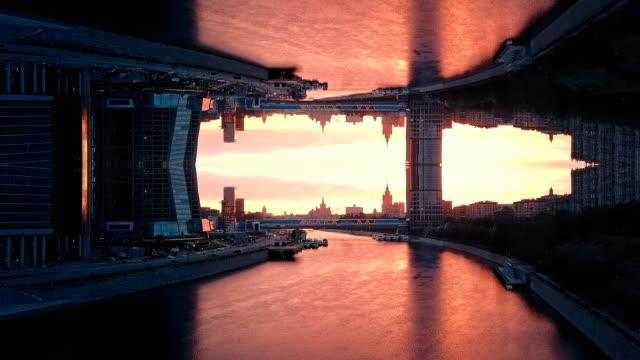 vídeos de stock e filmes b-roll de futuristic city aerial background. mirror effect - surrealismo