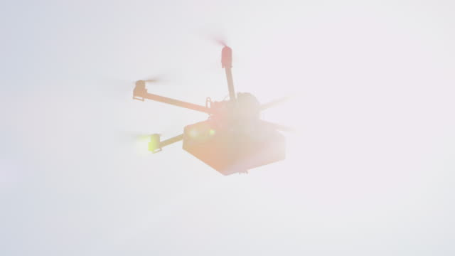 CLOSEUP LENS FLARE: Futuristic delivery drone flying Christmas present over sun video