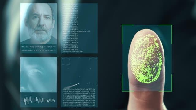 futuristic digital processing of fingerprints as man holds his hand against a  modern fingerprint scanner. futuristic digital technology and transparent citizen concept. - идентификация личности стоковые видео и кадры b-roll