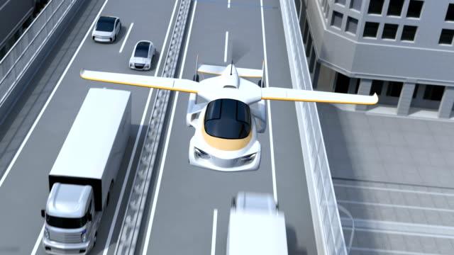 futurystyczny latający samochód latający nad autostradą - pasażer filmów i materiałów b-roll