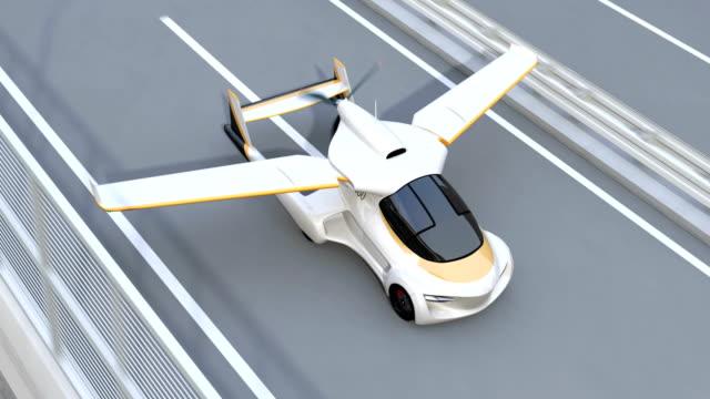 未来の空飛ぶ車を高速道路から脱ぐ - 乗客点の映像素材/bロール