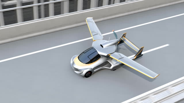 futuristic flying car takes off from highway - na biegu filmów i materiałów b-roll