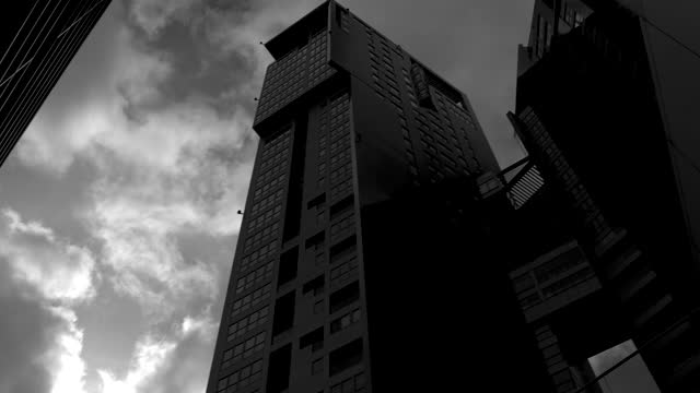 Futuristic modern skyscrapers. Architecture in black and white mood. Dolly shot Futuristic modern skyscrapers. Architecture in black and white mood. Dolly shot. High quality 4k footage black and white architecture stock videos & royalty-free footage