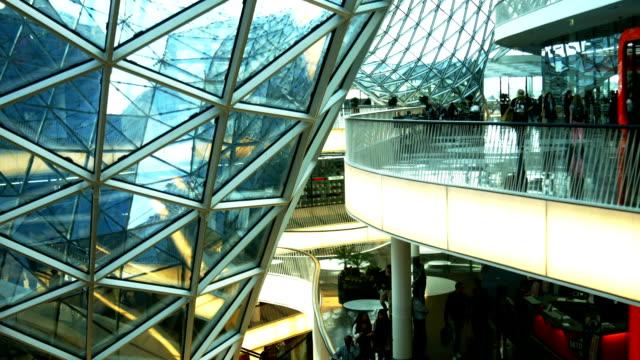 futuristic shopping mall tilt up (4k/uhd to hd) - realtid bildbanksvideor och videomaterial från bakom kulisserna