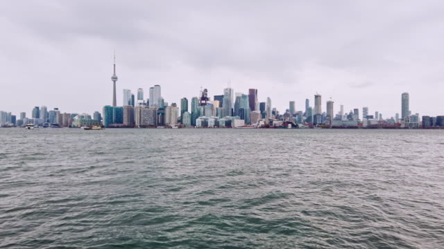 futuristic toronto skyline from lake ontario - lakeshore stock videos & royalty-free footage