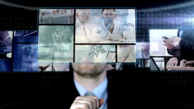 Futuristic Touch Screen. Businessman working. video