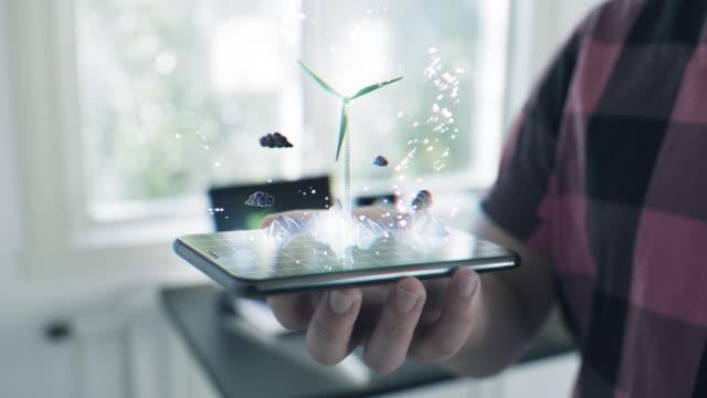 Futuristiskt vindturbin hologram på en smart telefon video