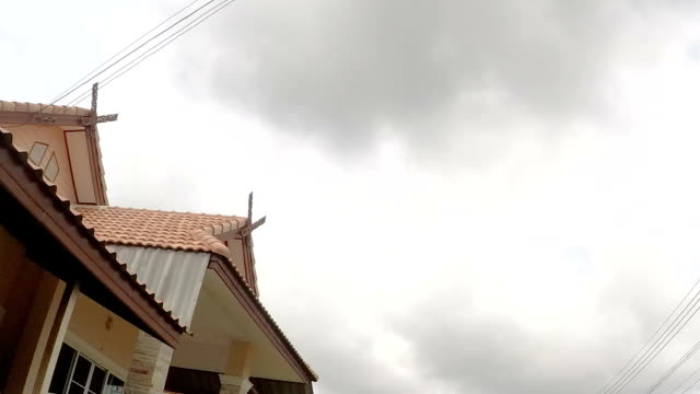 Gable roof house in northern thai style with cloud in the sky video