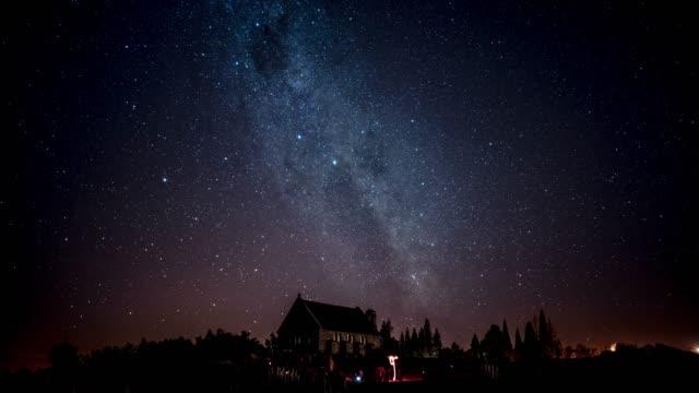 stockvideo's en b-roll-footage met galaxy over kerk - mist donker auto