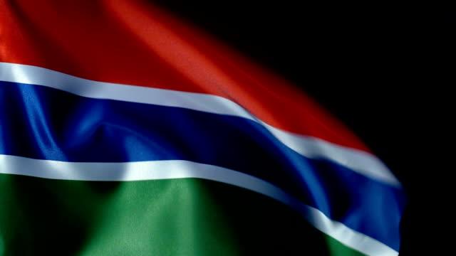 gambia flag flapping - dakar video stock e b–roll
