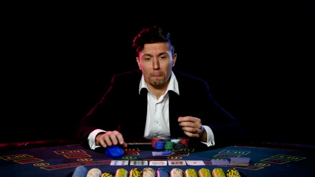 Gambler bets on the online casino and loses. Close up video