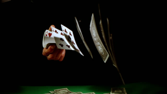 SLO MO Gambler flicking playing cards