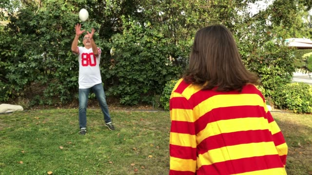 CC-Kraft2-GameDay Father and daughter play football in yard pre game stock videos & royalty-free footage