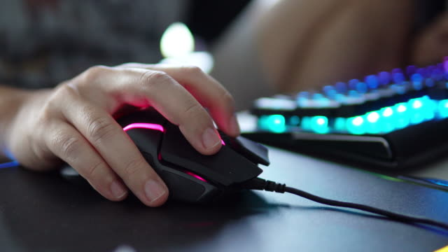 Gamer Hand playing computer games on mouses.