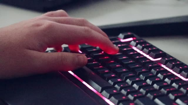 Gamer Playing Online Video Game, Hands Close Up Close Up Of Teenage boy With Hands On Keyboard Gaming At Home donna stock videos & royalty-free footage