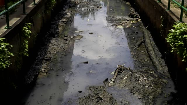 garbage and sewage from house and factoy  industrial flow to canal in capital city.