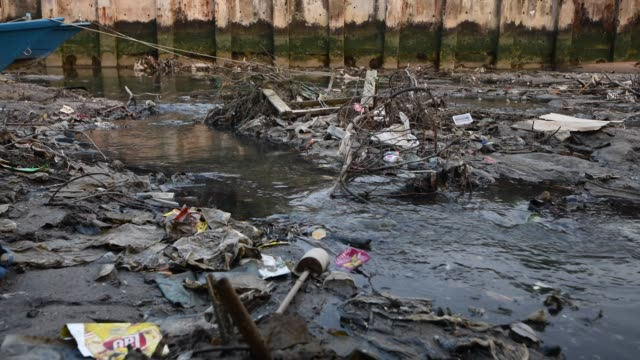Garbage and sewage from houses and factory industrial  to the sea drainage canals Into the sea video