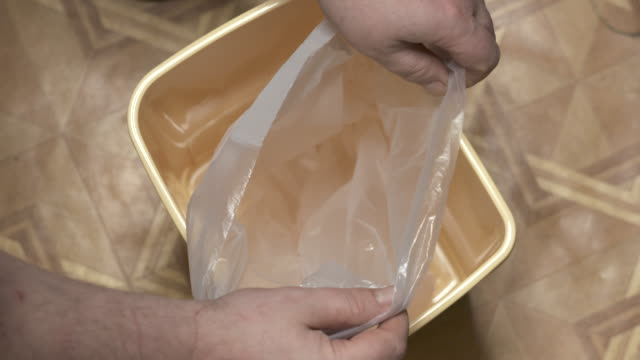 Garbage bag replacement in small kitchen trash can swing bin Garbage bag replacement in small kitchen trash can swing bin leftovers stock videos & royalty-free footage