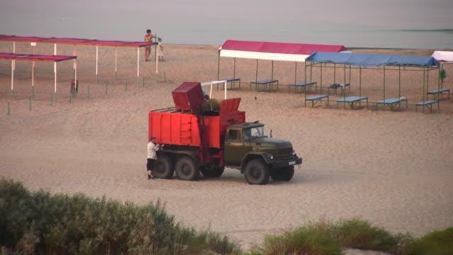 garbage car on beach video