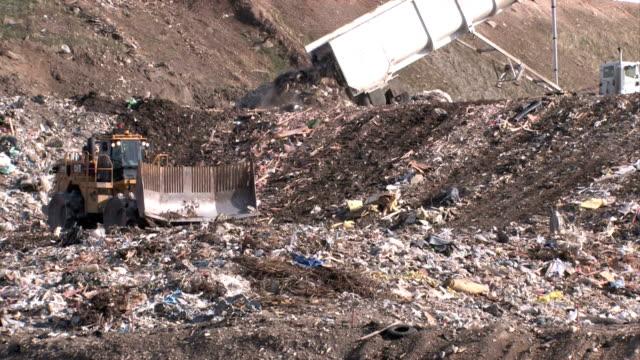 Garbage dump dozers and trucks video