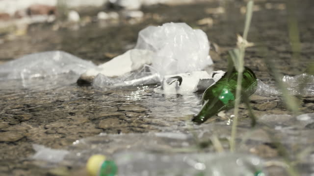 garbage floating on the surface of the water - earth day stock videos & royalty-free footage