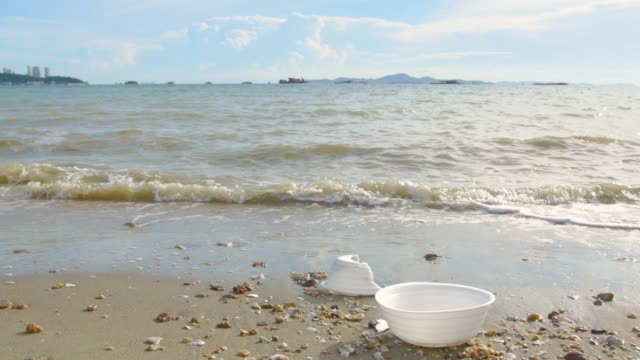 Garbage plastic cup on the beach video