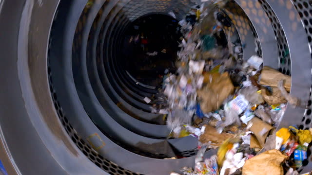 garbage sorting machine on a waste recycling plant. - attrezzatura industriale video stock e b–roll