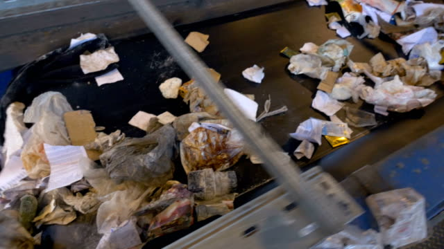 Garbage, trash, rubbish conveyor on a waste recycling plant. video