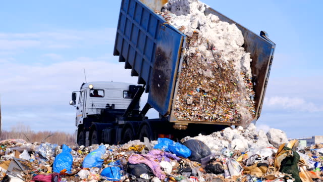 Garbage truck disposed trash on the landfill. Vehicle transporting garbage to waste. video