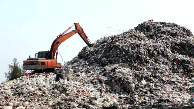 garbage truck moves trash in a landfill site, pollution, Global warming video
