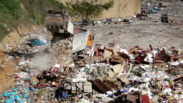 Garbage truck on landfill video