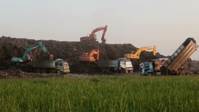 Garbage Trucks work on the landfill video