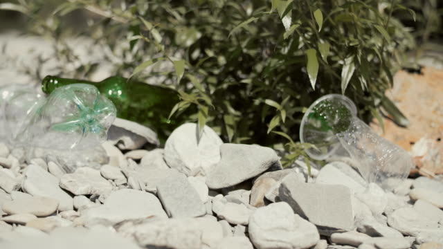 garbage washed up on the riverside - earth day stock videos & royalty-free footage