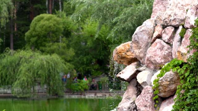 Garden waterfall from Laterite rock Garden waterfall from Laterite rock. durability stock videos & royalty-free footage